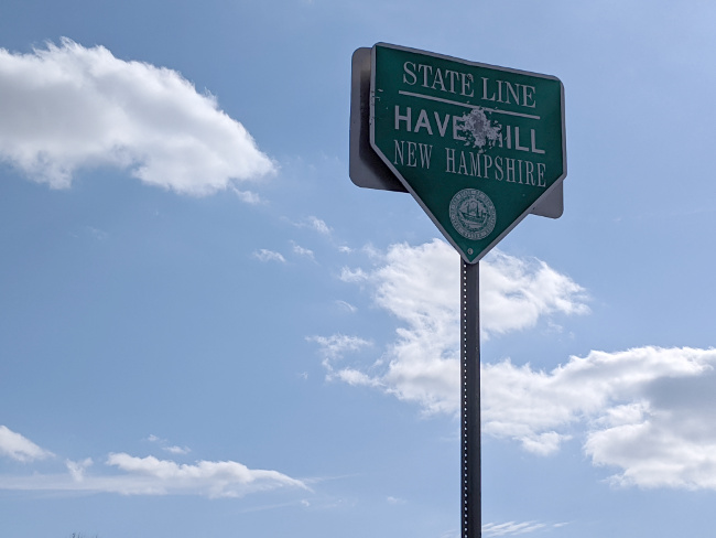 New Hampshire State Line Sign